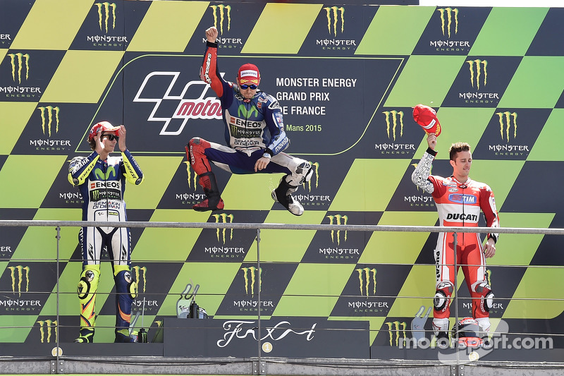 Podium: second place Valentino Rossi and winner Jorge Lorenzo, Yamaha Factory Racing and third place