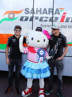 Sergio Perez, Sahara Force India F1, and team mate Nico Hulkenberg, Sahara Force India F1 with Hello Kitty