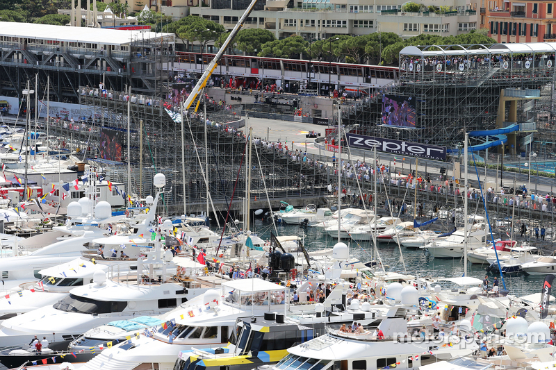Boats in the scenic Monaco Harbour passed by Daniil Kvyat, Red Bull Racing RB11