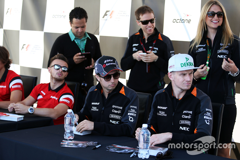 Sergio Perez, Sahara Force India F1 and team mate Nico Hulkenberg, Sahara Force India F1 sign autographs for the fans