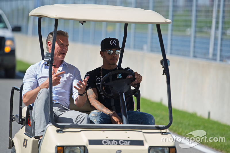 Lewis Hamilton, Mercedes AMG F1 drives the circuit with David Coulthard, Red Bull Racing and Scuderi