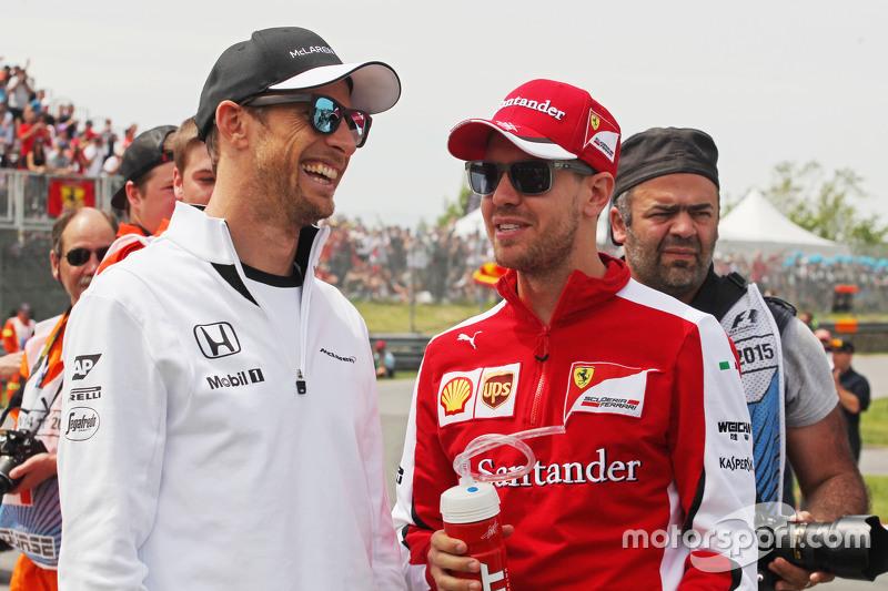 Jenson Button, McLaren with Sebastian Vettel, Ferrari on the drivers parade