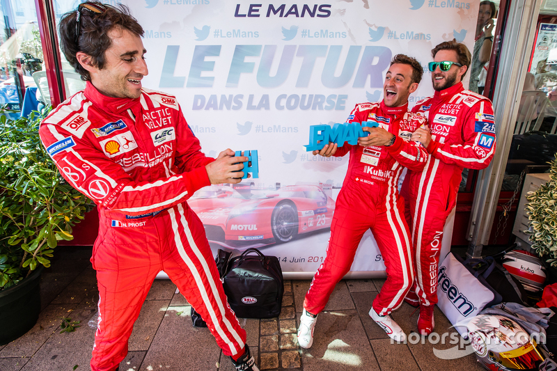 Rebellion Racing: Nicolas Prost and Mathias Beche break the #LEMANS sign while Nick Heidfeld looks on