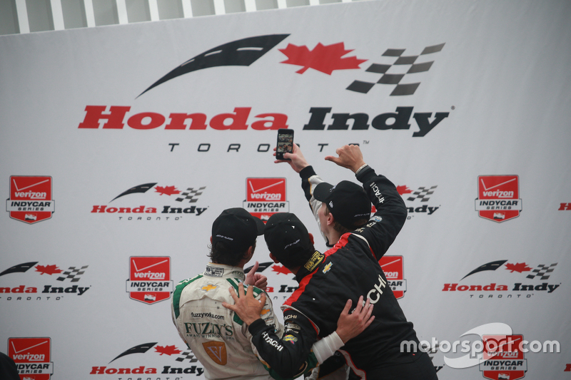 Podium: Race winner Josef Newgarden, CFH Racing Chevrolet, second place Luca Filippi, CFH Racing Che
