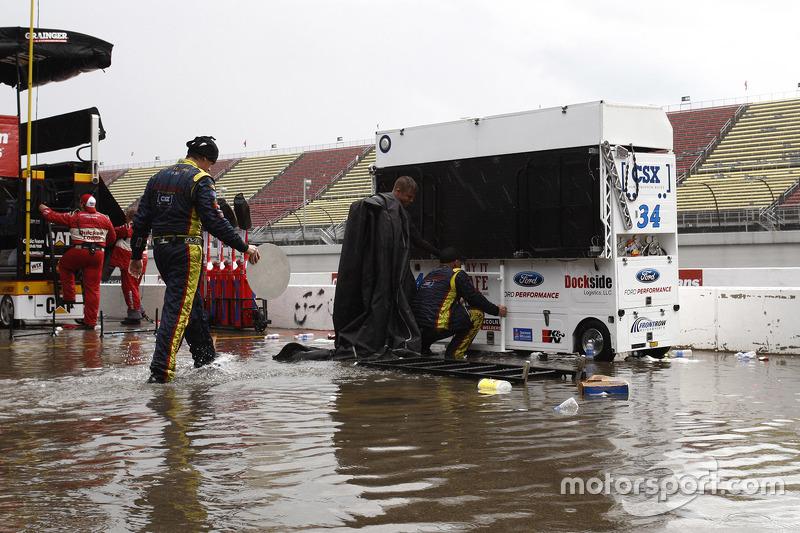 Rain water floods pit road