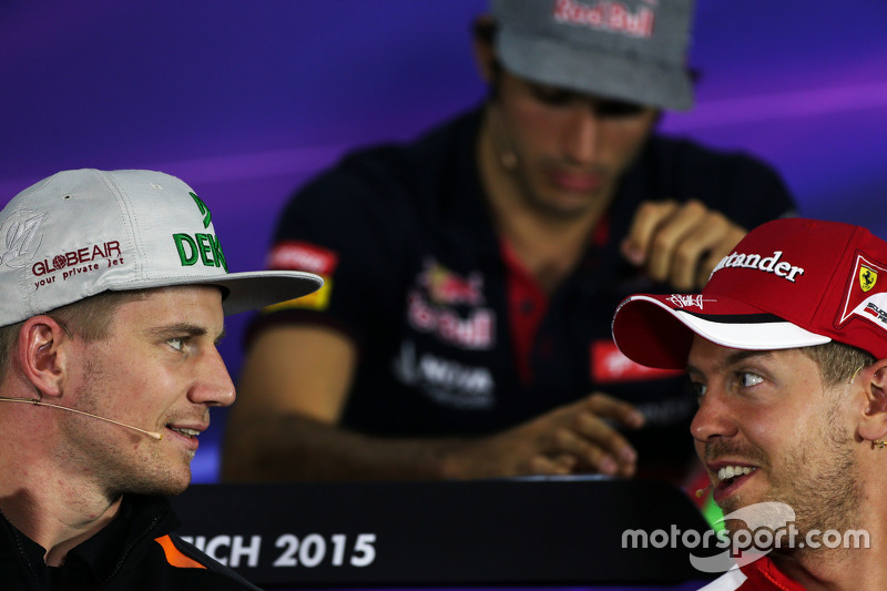 (L to R): Nico Hulkenberg, Sahara Force India F1 with Sebastian Vettel, Ferrari in the FIA Press Conference