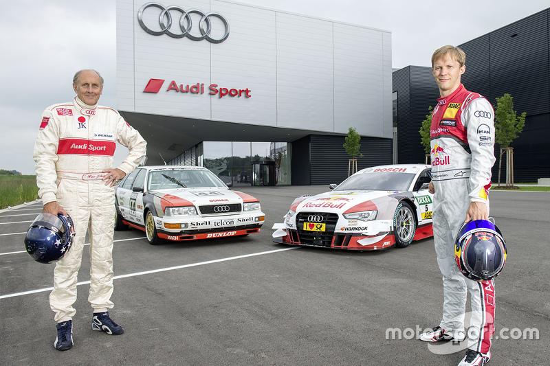 Hans-Joachim Stuck with Mattias Ekström celebrating a throwback livery celebrating Audi's debut DTM win from 1990 at the Norisring