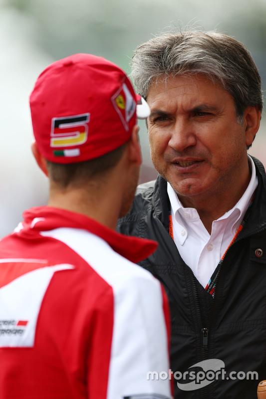 Sebastian Vettel, Ferrari bersama Pasquale Lattuneddu of FOM