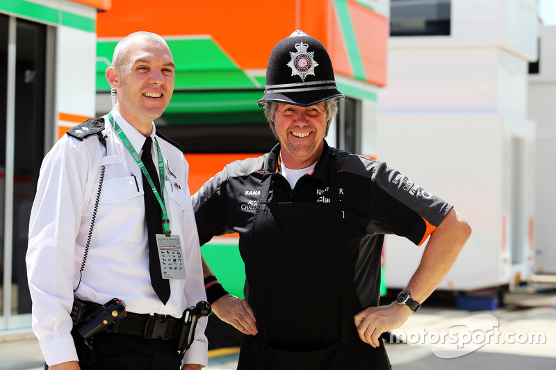 Neil Dickie, Sahara Force India F1 Team, with a Policeman