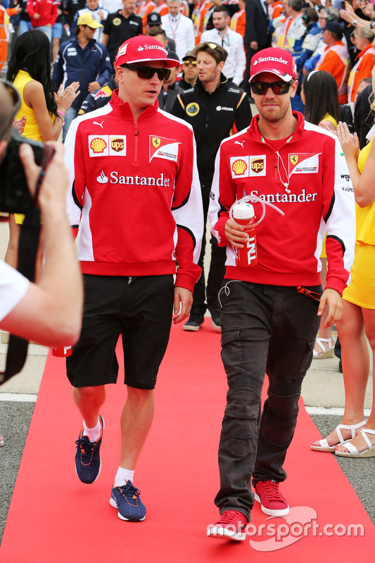 (L to R): Kimi Raikkonen, Ferrari with team mate Sebastian Vettel, Ferrari on the drivers parade