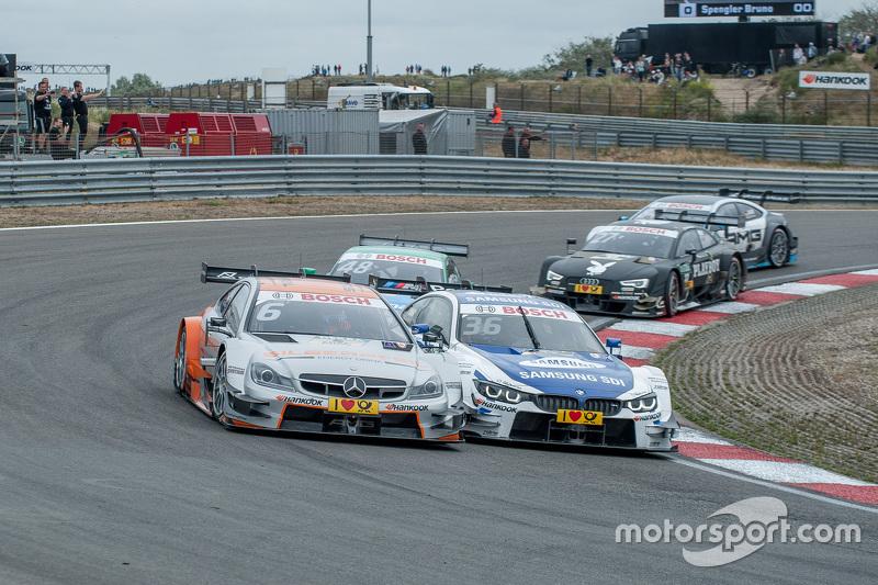 Pertarungan antara: Robert Wickens, HWA AG Mercedes-AMG C63 DTM; Maxime Martin, BMW Team RMG BMW M4 DTM