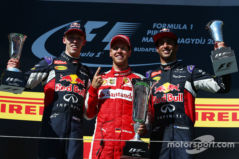 Podium: second place Daniil Kvyat, Red Bull Racing and winner Sebastian Vettel, Ferrari and third pl