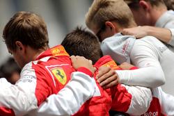 Drivers during the minute of silence для Жуль Бьянкі, Себастьян Феттель, Scuderia Ferrari