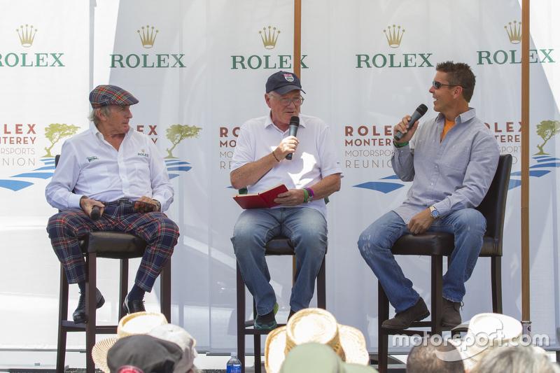 Sir Jackie Stewart, dan Scott Pruett banter bersama moderator Murray Smith