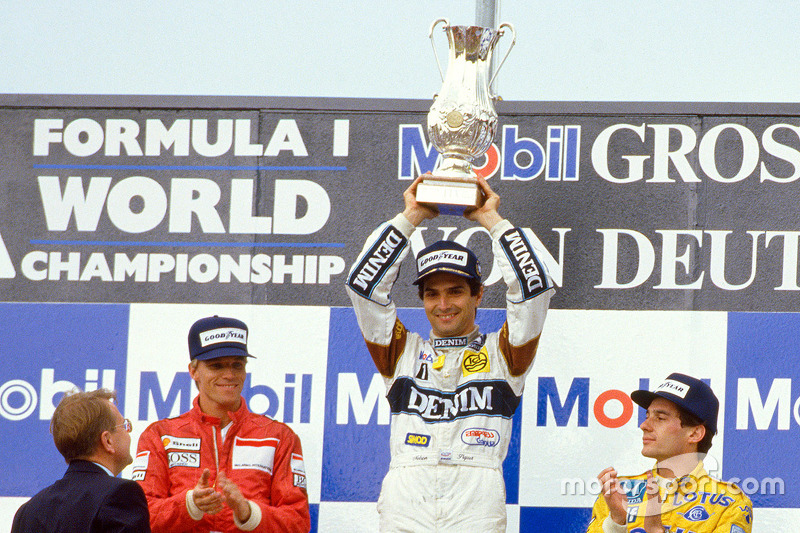 Podium: race winner Nelson Piquet, Williams, second place Stefan Johansson, Ferrari, third place Ayrton Senna, Lotus