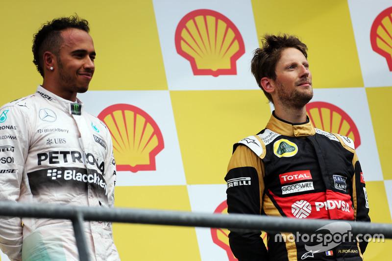Podium: Race winner Lewis Hamilton, Mercedes AMG F1 with third place Romain Grosjean, Lotus F1 Team