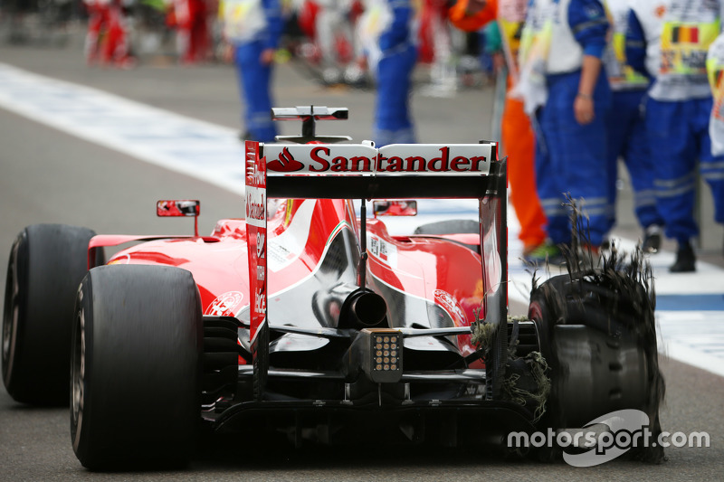 Sebastian Vettel, Ferrari with his punctured Pirelli tyre