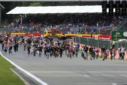 Fans invade the circuit to head to the podium