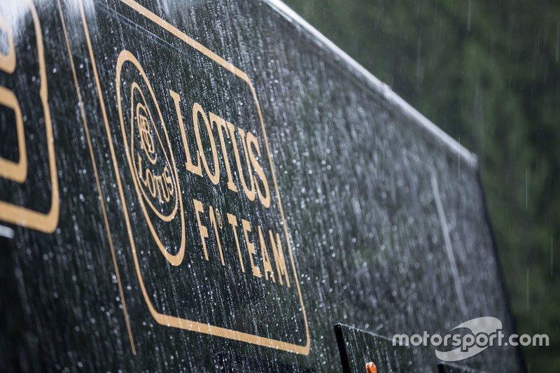 Lotus F1 Team truck, dan logo in a post race rain storm