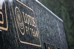 Lotus F1 Team truck, dan logo in a post race rain storm