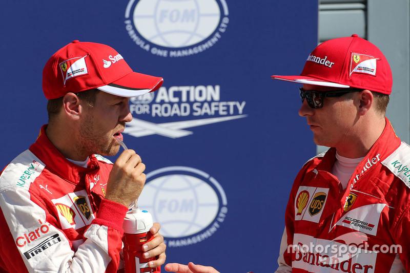 Segundo Kimi Raikkonen, Ferrari e terceiro Sebastian Vettel, Ferrari