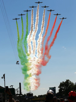 An air display flies over the grid