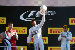 The podium: Sebastian Vettel, Ferrari, second; Lewis Hamilton, Mercedes AMG F1, race winner; Felipe Massa, Williams, third