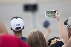 Fans record the action from the stands