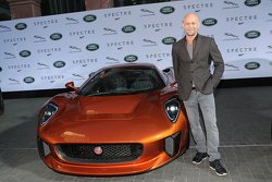Juergen Vogel next to a Jaguar C-X75 during the presentation of the Jaguar Land Rover vehicles starring in the new Bond film Spectre