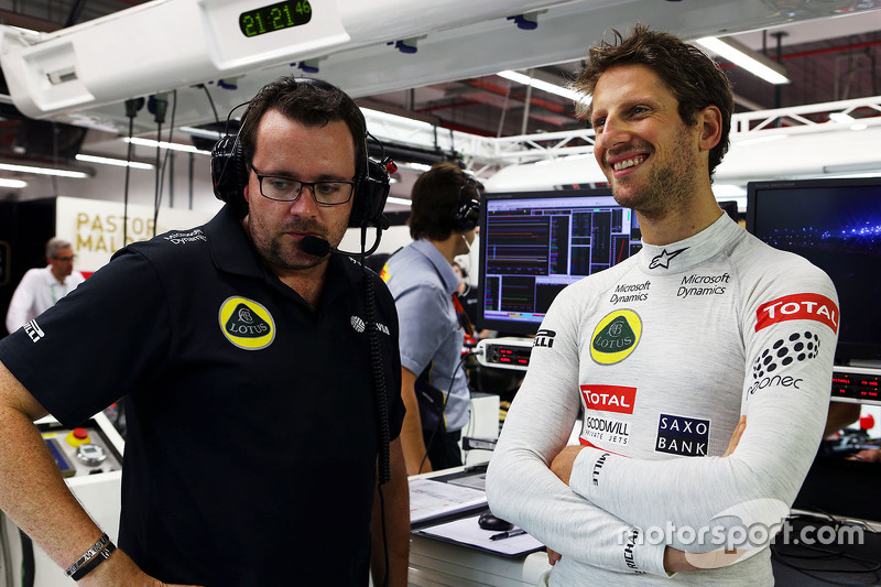 Romain Grosjean, Lotus F1 Team with Julien Simon-Chautemps, Lotus F1 Team Race Engineer