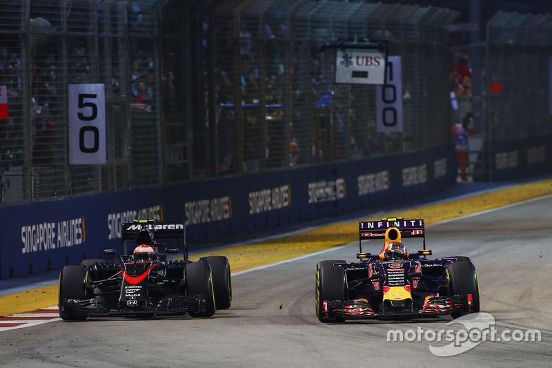 Jenson Button, McLaren MP4-30 and Daniil Kvyat, Red Bull Racing RB11