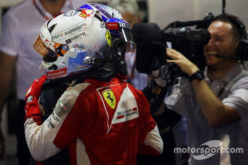 Race winner Sebastian Vettel, Ferrari celebrates in parc ferme with second placed Daniel Ricciardo, Red Bull Racing
