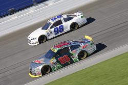 Dale Earnhardt Jr., Hendrick Motorsports Chevrolet and Reed Sorenson, Premium Motorsports Ford