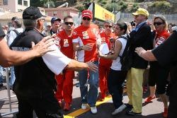 Kimi Raikkonen, Scuderia Ferrari, doesn't stop to sign autographs