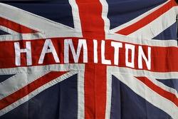 A flag for Lewis Hamilton, McLaren Mercedes