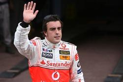 Pole winner Fernando Alonso celebrates