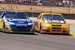 Jimmie Johnson and Dave Blaney battle