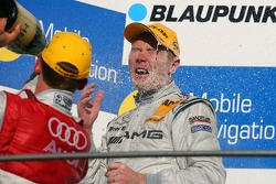 Podium: Mattias Ekström, Audi Sport Team Abt Sportsline, spraying champagne over Mika Hakkinen, Team HWA AMG Mercedes