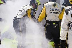 Paul Menards brings in his Menards Chevrolet into the pits