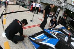 Quifel-ASM team members prepare pit area