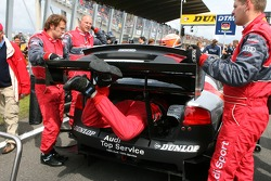 Audi mechanic making the last adjustments to the rear suspension setup