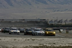 GT start: #70 SpeedSource Mazda RX-8: David Haskell, Sylvain Tremblay, Nick Ham and #07 Banner Racing Pontiac GXP.R: Paul Edwards, Kelly Collins, Andy Pilgrim battle for the lead