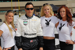 Michael Shank Racing driver Henri Zogaib poses with three gorgeous Playboy Playmates