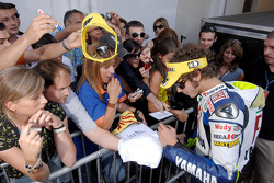 Valentino Rossi signs autographs
