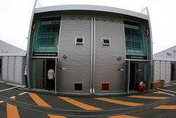 The buildings of McLaren Mercedes and Scuderia Ferrari in the paddock