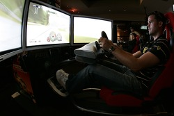Petit Preview Party at Atlantic Station: Dirk Muller tries the racing sim at the Fox Sports Grill party