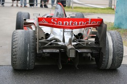 Lewis Hamilton's, McLaren Mercedes parked at the side of the track with badly worn tyres
