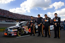 Travis Kvapil and crew line up for the National Anthem