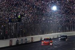 Jeff Gordon takes the checkered flag