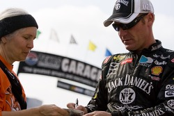 Clint Bowyer signs an autograph